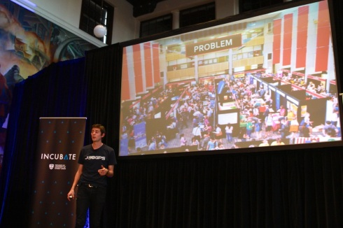Mike Williams, co-founder of JobGPS pitches on stage